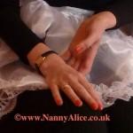 Nanny's slender caring hands - London AB/DL nursery, UK